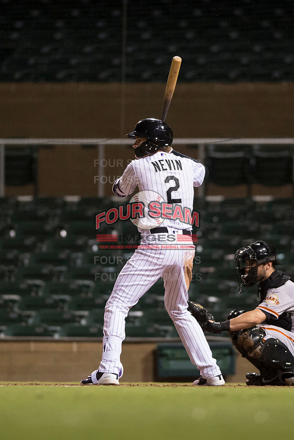 Salt River Rafters first baseman Tyler Nevin (2), of the Colorado Rockies organization, at bat in front of catcher Matt Winn (16) during an Arizona Fall League game against the Scottsdale Scorpions at Salt River Fields at Talking Stick on October 11, 2018 in Scottsdale, Arizona. Salt River defeated Scottsdale 7-6. (Zachary Lucy/Four Seam Images)