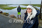 Ann Kennedy (front right) with Kevin Kennedy at their flooded land in Kilshannig, Castlegregory on Saturday morning.