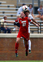 WINSTON-SALEM, NORTH CAROLINA - September 01, 2013:<br /> Katie Walz (27) of Louisville University goes up for a header against Ally Berry (8) of Wake Forest University during a match at the Wake Forest Invitational tournament at Wake Forest University on September 01. The match was abandoned early in the second half due to severe weather with Wake leading 1-0.
