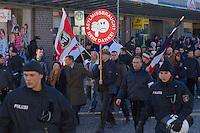 Zum 75. Jahrestag der Reichspogromnacht marschierten bis zu 200 Neonazis von der NPD durch die mecklenburgische Kleinstadt Friedland und protestierten gegen ein geplantes Fluechtlingsheim.<br />Mehrere hundert Gegendemonstranten demonstrierten lautstark gegen den Aufmarsch.<br />300 Polizeibeamte sicherten den reibungslosen Ablauf der NPD-Veranstaltung.<br />Rechts mit Ordnerbinde vor schwarz-weiss-roter Fahne Marko Mueller, NPD-Ordnungsdienst NPD-MV. <br />Links mit braunem Mantel: Udo Pastoers, Fraktionsvorsitzender der NPD im Mecklenburger Landtag und Mitglied im Bundesvorstand der NPD.<br />Mit rundem Plakat: Stefan Koester, NPD-Landtagsabgeordneter MV, NPD-Bundesgeschaeftsfuehrer, Wiking Jugend (WJ).<br />Rechts hinter Koester: Marko Mueller, Ordnungsdienst NPD-MV.<br />9.11.2013, Berlin<br />Copyright: Christian-Ditsch.de<br />[Inhaltsveraendernde Manipulation des Fotos nur nach ausdruecklicher Genehmigung des Fotografen. Vereinbarungen ueber Abtretung von Persoenlichkeitsrechten/Model Release der abgebildeten Person/Personen liegen nicht vor. NO MODEL RELEASE! Don't publish without copyright Christian-Ditsch.de, Veroeffentlichung nur mit Fotografennennung, sowie gegen Honorar, MwSt. und Beleg. Konto:, I N G - D i B a, IBAN DE58500105175400192269, BIC INGDDEFFXXX, Kontakt: post@christian-ditsch.de<br />Urhebervermerk wird gemaess Paragraph 13 UHG verlangt.]