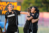 Marta (10) of the Western New York Flash celebrates scoring with Ali Riley (3) and Christine Sinclair (12). The Western New York Flash defeated Sky Blue FC 4-1 during a Women's Professional Soccer (WPS) match at Yurcak Field in Piscataway, NJ, on July 30, 2011.