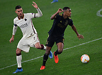 Football: Europa League - quarter final 2nd leg AS Roma vs Ajax, Olympic Stadium. Rome, Italy, March 15, 2021.<br /> Roma's captain Lorenzo Pellegrini (L) in action with Ajax's Ryan Gravenberch (R) during the Europa League football match between Roma at Rome's Olympic stadium, Rome, on April 15, 2021.  <br /> UPDATE IMAGES PRESS/Isabella Bonotto