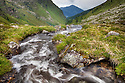 Stream running through high mountain valley. Nordtirol, Tirol,  Austrian Alps, Austria, 2300 metres, July.
