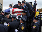Hartford firefighters lift the casket of their colleague, firefighter Kevin Bell, on to the hose bed of Hartford Engine 16, his engine, during a funeral service, Monday, Oct. 13, 2014, at First Cathedral Church in Bloomfield. Bell was killed at a house fire in last week Hartford. (Jim Michaud / Journal Inquirer)