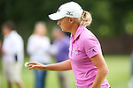 Stacy Lewis waves to the crowd on the 12th green at the LPGA Championship 2014 Sponsored By Wegmans at Monroe Golf Club in Pittsford, New York on August 13, 2014