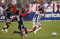 New England Revolution defender Jay Heaps (6) attempts a tackle on Pachuca CF forward Damian Alvarez (7). The New England Revolution defeated Pachuca CF 1-0 during a Group B match of the 2008 North American SuperLiga at Gillette Stadium in Foxborough, Massachusetts, on July 16, 2008.