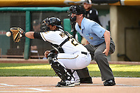Luis Martinez (20) of the Salt Lake Bees behind the plate with home plate umpire Scott Mahoney during the game against the Fresno Grizzlies at Smith's Ballpark on April 9, 2014 in Salt Lake City, Utah.  (Stephen Smith/Four Seam Images)