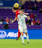 ORLANDO, FL - FEBRUARY 21: Allysha Chapman #2 of Canada goes up for a header with Mariana Larrouquette #19 of Argentina during a game between Canada and Argentina at Exploria Stadium on February 21, 2021 in Orlando, Florida.