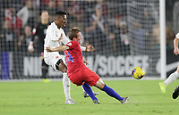 ORLANDO, FL - NOVEMBER 15: Jackson Yueill #14 of the United States sends a ball downfield during a game between Canada and USMNT at Exploria Stadium on November 15, 2019 in Orlando, Florida.