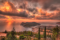 The sunset above village Assos in Kefalonia island, Greece