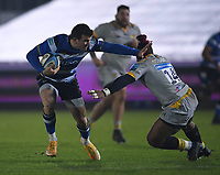 8th January 2021; Recreation Ground, Bath, Somerset, England; English Premiership Rugby, Bath versus Wasps; Ben Spencer of Bath hands off Paolo Odogwu of Wasps