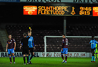 Fleetwood Town's defender Ash Eastham (5) receives yellow card number 4 of the season during the Sky Bet League 1 match between Scunthorpe United and Fleetwood Town at Glanford Park, Scunthorpe, England on 17 October 2017. Photo by Stephen Buckley/PRiME Media Images