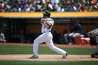 OAKLAND, CA - MAY 28:  Danny Valencia #26 of the Oakland Athletics hits a home run against the Detroit Tigers during the game at the Oakland Coliseum on Saturday, May 28, 2016 in Oakland, California. Photo by Brad Mangin