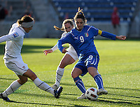 US defenders Ali Krieger (16) and Christie Rampone (3) close in on Italian forward Patrizia Panico (9).  The U.S. Women's National Team defeated Italy 1-0 at Toyota Park in Bridgeview, IL on November 27, 2010 to advance to the Women's World Cup in Germany.