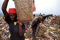 Kigali / Rwanda.Poor people working in Kigali dump. Life conditions are very hard.Violence and sexual abuse against women is one of the consequeses of the civil war and genocide run by Hutus against Tutsis in 1994.<br />