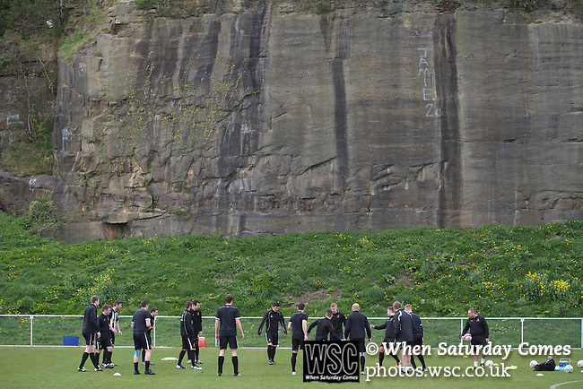 Cefn Druids AFC 1 Buckley Town 0, 12/04/2014. The Rock, Cymru Alliance league. The home players warming up at The Rock, Rhosymedre, home to Cefn Druids AFC, prior to the club's final home game of the season against Buckley Town in the Cymru Alliance league. Druids, reputedly the oldest football club in Wales, won the Alliance league the previous week and were awarded the trophy after the Buckley Town match, which they won by 1 goal to nil, watched by a crowd of 246. The Cymru Alliance was the second tier of Welsh football based in north and mid Wales, promotion from which led directly into the Welsh Premier League. Photo by Colin McPherson.