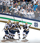 Feb. 8, 2013; Hockey players celebrate a goal during the annual 'White Out' game against Michigan...Photo by Matt Cashore/University of Notre Dame