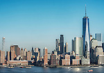 View of the Freedom Tower and nearby buildings in midafternoon from across the Hudson River in Jersey City