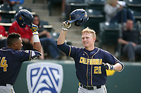 Andrew Vaughn (20) of the California Bears celebrates with teammate Jonah Davis (14) after hitting a home run during a game against the UCLA Bruins at Jackie Robinson Stadium on March 25, 2017 in Los Angeles, California. UCLA defeated California, 9-4. (Larry Goren/Four Seam Images)