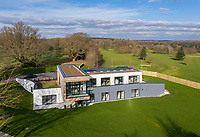 BNPS.co.uk (01202) 558833<br /> Pic: Savills/BNPS<br /> <br /> The house sits in 1.5 acres of grounds<br /> <br /> A striking high-tech eco home that would not look out of place in a Bond film is on the market for offers over £4m.<br /> <br /> Skyfall is a luxurious house in the Berkshire countryside designed to be totally carbon free.<br /> <br /> With its luxe white interiors, minimalist decor and stunning countryside surroundings, the five-bedroom property would fit effortlessly into 007's world.<br /> <br /> But it's the eco features of the brand new house, which is just outside the village of Taplow with Huntswood Golf Course next door, that make it really stand out.