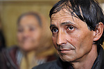 Todor Janosev is a member a Roma congregation of The United Methodist Church in Srbobran, Serbia. Here he listens to the sermon during a worship service. Behind him is Mira Janosev.