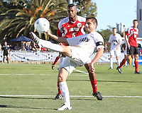 Michael Nanchoff #9 of the University of Akron hooks the ball over Andrew Farrell #5 of the University of Louisville during the 2010 College Cup final at Harder Stadium, on December 12 2010, in Santa Barbara, California. Akron champions, 1-0.
