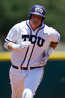 Designated Hitter Kevin Cron #00 of the Texas Christian University Horned Frogs trots around the bases after homering during the NCAA Regional baseball game against the Ole Miss Rebels on June 1, 2012 at Blue Bell Park in College Station, Texas. Ole Miss defeated TCU 6-2. (Andrew Woolley/Four Seam Images)