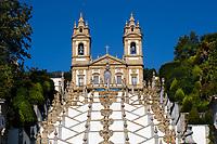 Baroque stairway and church facade under golden sunset light, in the UNESCO World Heritage Bom Jesus do Monte sanctuary, near Braga, Portugal Europe