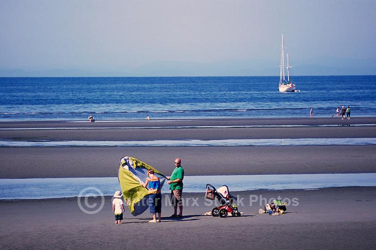 Summer Recreational Activities at White Rock, BC, British Columbia, Canada - Family sunbathing on Sandy Beach along Semiahmoo Bay