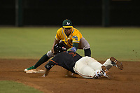 AZL Athletics shortstop Alexander Campos (8) applies the tag to David Villar (9) during an Arizona League game against the AZL Giants Black at the San Francisco Giants Training Complex on June 19, 2018 in Scottsdale, Arizona. AZL Athletics defeated AZL Giants Black 8-3. (Zachary Lucy/Four Seam Images)