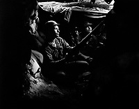 Infantrymen of the 27th Infantry Regiment, near Heartbreak Ridge, take advantage of cover and concealment in tunnel positions, 40 yards from the Communists.  August 10, 1952. Feldman. (Army)<br /> NARA FILE #:  111-SC-410716<br /> WAR & CONFLICT BOOK #:  1427