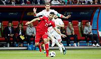 KAZAN - RUSIA, 20-06-2018: Mehdi TAREMI (Der) jugador de RI de Irán disputa el balón con Sergio RAMOS (C) (Izq) jugador de España durante partido de la primera fase, Grupo B, por la Copa Mundial de la FIFA Rusia 2018 jugado en el estadio Kazan Arena en Kazán, Rusia. /  Mehdi TAREMI (R) player of IR Iran fights the ball with Sergio RAMOS (C)(L) player of Spain during match of the first phase, Group B, for the FIFA World Cup Russia 2018 played at Kazan Arena stadium in Kazan, Russia. Photo: VizzorImage / Julian Medina / Cont