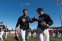 Oregon State Beavers relief pitcher Joey Mundt (25) is congratulated by Adley Rutschman (35) after a game against the Gonzaga Bulldogs on February 16, 2019 at Surprise Stadium in Surprise, Arizona. Oregon State defeated Gonzaga 9-3. (Zachary Lucy/Four Seam Images via AP)