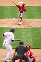 Louisville Bats pitcher Hunter Greene (3) delivers a pitch as Tanner Anderson (47) squares to bunt during a game against the Indianapolis Indians on August 25, 2021 at Victory Field in Indianapolis, Indiana.  (Mike Janes/Four Seam Images)