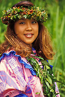 Hula Dancer adorned with lei.