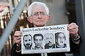 """Dr Jim Swire, whose daughter Flora died when Pan Am Flight 103 crashed on the town of Lockerbie, Scotland, holds photographs of the men that he believes were responsible.     <br /> Dr Swire was at the Scottish Parliament<br /> to watch the premiere of Al Jazeera's, """"Lockerbie: What Really Happened?""""."""