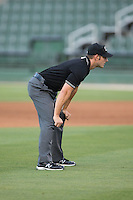 Umpire Ben Sonntag handles the calls on the bases during the South Atlantic League game between the Lexington Legends and the Kannapolis Intimidators at CMC-Northeast Stadium on May 26, 2015 in Kannapolis, North Carolina.  The Intimidators defeated the Legends 4-1.  (Brian Westerholt/Four Seam Images)