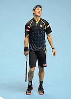 Kei Nishikori (JPN) reacts after losing a point to Novak Djokovic (SRB) during Day One of the Barclays ATP World Tour Finals 2015 played at The O2, London on November 15th 2015