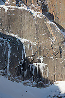 Ice formations on the Diamond, Long's Peak, Rocky Mountain National Park.  The two tiny specks in the lower left region are ice climbers.  The scale of these formations is unbelievably huge.