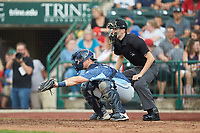West Michigan Whitecaps catcher Cooper Johnson (37) reaches for a pitch as home plate umpire Nathan Diederich looks on during the game against the Fort Wayne TinCaps at Parkview Field on August 5, 2019 in Fort Wayne, Indiana. The TinCaps defeated the Whitecaps 9-3. (Brian Westerholt/Four Seam Images)