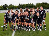 The WPS All Stars pose with the championship trophy after the WPS All Star match at Anheuser-Busch Soccer Park, in St. Louis, MO, June 7, 2009. The WPS All Stars won the match 4-2.