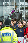 © Joel Goodman - 07973 332324 - all rights reserved . 20/03/2010 . Bolton , UK . Counter protesters , opposed to the EDL , beside a statue of Bolton son Fred Dibnah . The English Defence League ( EDL ) hold a demonstration in Bolton , opposed by Unite Against Fascism ( UAF ) . Photo credit : Joel Goodman