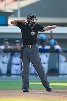 Home plate umpire Reid Joyner calls a batter out on strikes during the Appalachian League game between the Princeton Rays and the Burlington Royals at Burlington Athletic Park on July 11, 2014 in Burlington, North Carolina.  The Rays defeated the Royals 5-3.  (Brian Westerholt/Four Seam Images)