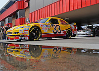 Feb 21, 2009; Fontana, CA, USA; NASCAR Sprint Cup Series driver Clint Bowyer heads out of the garage during practice for the Auto Club 500 at Auto Club Speedway. Mandatory Credit: Mark J. Rebilas-