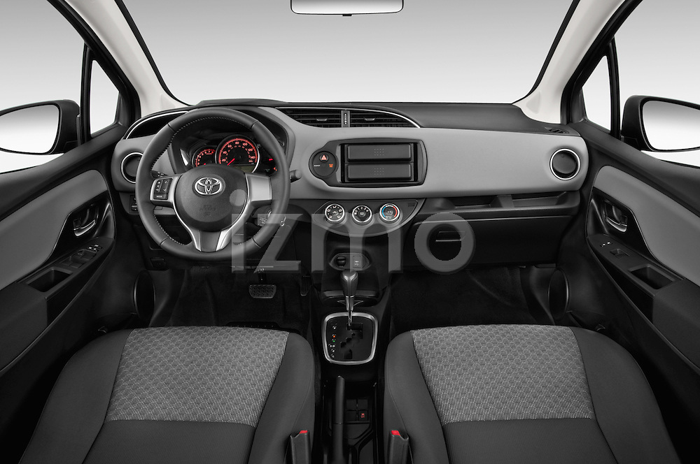 Stock photo of straight dashboard view of a 2015 Toyota Yaris Le 5 Door Hatchback