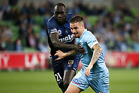 22nd May 2021, Melbourne, Australia;  Jamie Maclaren of Melbourne City and Ruon Tongyik of the Central Coast Mariners grapple for the ball during the Hyundai A-League football match between Melbourne City FC and Central Coast Mariners at AAMI Park in Melbourne, Australia.