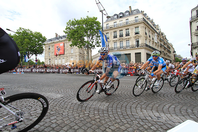 The breakaway group including Sylvain Chavanel (FRA) Quick-Step rounds the Arc de Triomphe hairpin for the first time during the final Stage 20 of the 2010 Tour de France running 102.5km from Longjumeau to Paris Champs-Elysees, France. 25th July 2010.<br /> (Photo by Eoin Clarke/NEWSFILE).<br /> All photos usage must carry mandatory copyright credit (© NEWSFILE | Eoin Clarke)