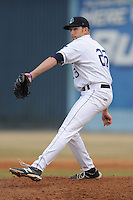 Asheville Tourists pitcher Troy Neiman #23 delivers a pitch during game one of a double header against the West Virginia Power at McCormick Field on April 8, 2014 in Asheville, North Carolina. The Power defeated the Tourists 6-5. (Tony Farlow/Four Seam Images)