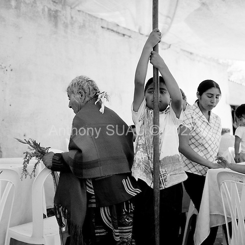 Francisco Villa, Mexico.June 3, 2007..In a small town locals celebrate the Sacred Trinity at the tiny church..