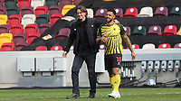 Brentford Manager, Thomas Frank, walks across the pitch at the final whistle with Watford's Andre Gray, who previously played for Brentford during Brentford vs Watford, Sky Bet EFL Championship Football at the Brentford Community Stadium on 1st May 2021